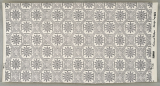 "On white ground, small scale pattern in black: grid of rectangles with saw-toothedge, overcrossed symmetrically with diaper pattern of black dots. Rosettes in centers of alternate rectangles. Printed in margin: ""Durham Scalamandre Wallpaper design wp 8673."""