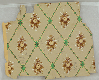 Naturalistic bouquets and small diamond pattern with printed background on buff paper.