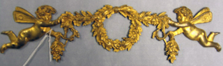 Wreath between cherubs in the French Empire style.