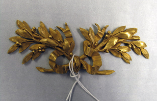 Two ribbon-tied crossed laurel bows.