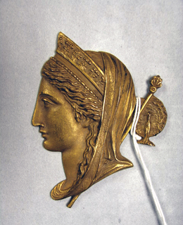 Profile bust of Juno with peacock hairpin.