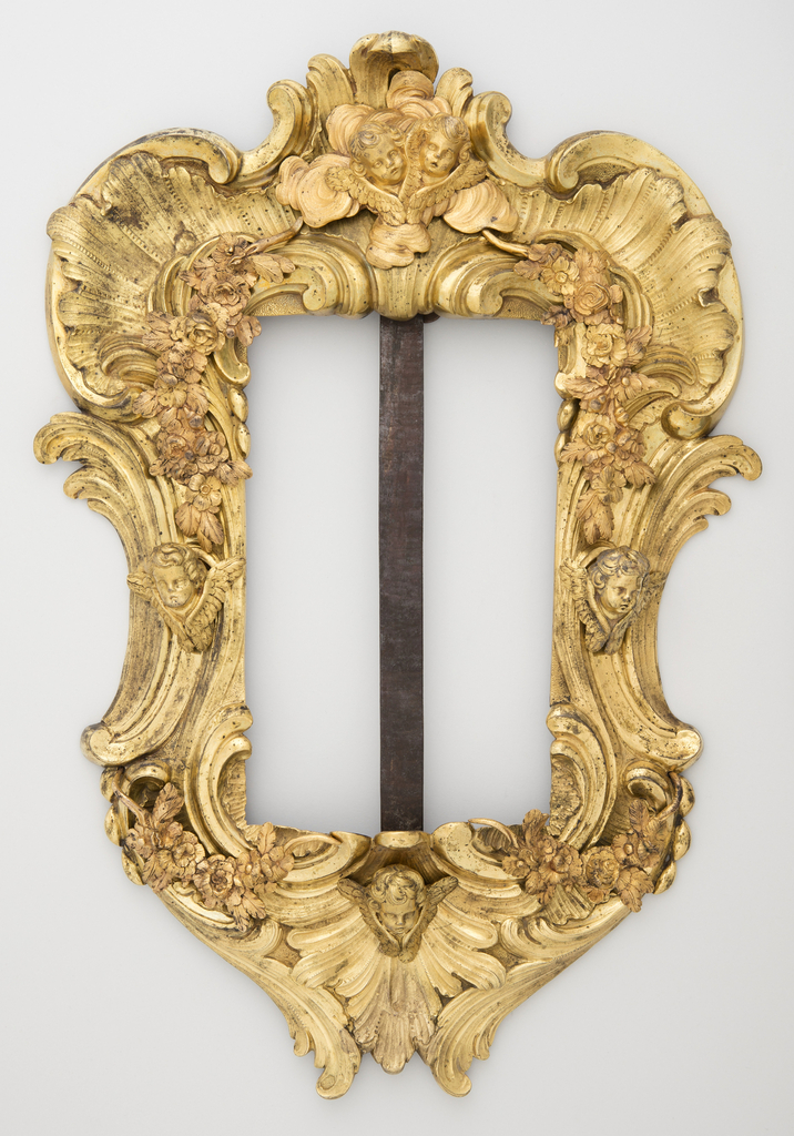 Roccoco frame with scrolls and cherub heads.