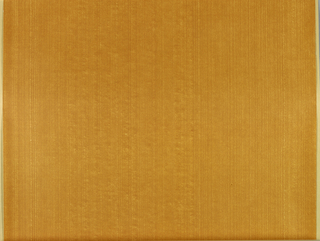 Design with wood grain pattern of thin, slightly wavy brown vertical lines; warm caramel ground.