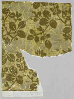 Pattern of metallic gold foliage with gray blossoms (faded white) on yellow ground embossed to imitate a fabric weave. Aesthetic or anglo-Japanesque in style.