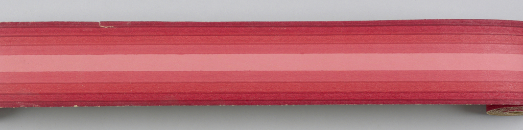 Red band in center with red bands deepening in hue toward edges on either side of center Duro-Stripes.