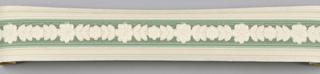 Off-white central floral band over green with white/off-white bands on off-white ground. Matching ready-pasted border.