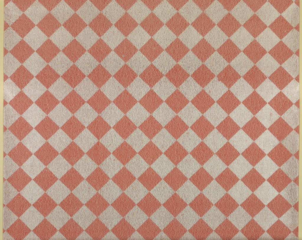 Red-and-white diamond check design with texture effect of dense fine crazing (like it's chemically breaking down?)