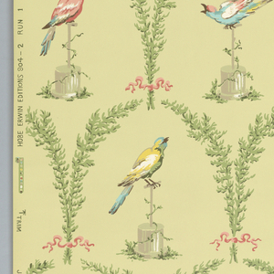 Depicting birds, printed in colors, within an arched foliate framework forming a fish scale pattern. Printed on green ground.