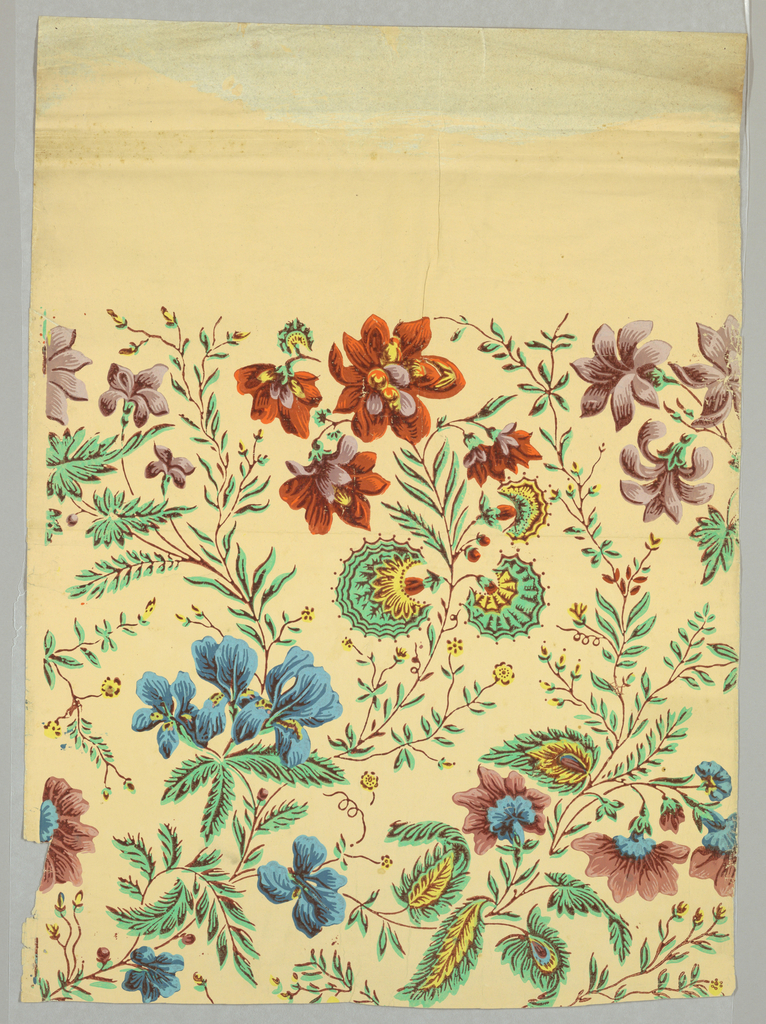 All-over vining floral pattern, with iris and various other flowers. Printed in blue, green, orange, mauve, yellow and brown on beige ground.