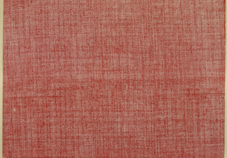 Paper printed with texture effect in red on white ground reminiscent of thin worn fabric