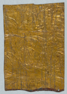 Totally gilded surface, with design including scrolling foliage and flowers.
