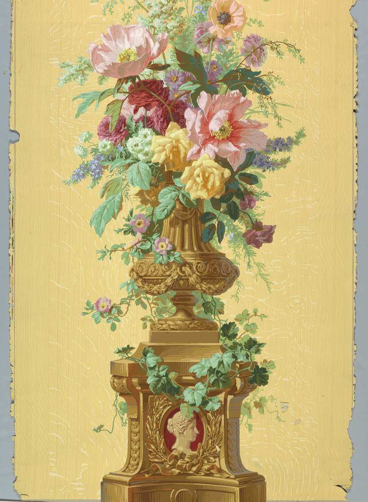 Urn of flowers sitting on vine-covered pedestal. Burgundy cameo in base. Printed on wood grain ground.