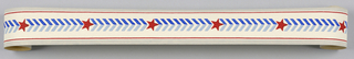 Central pattern of red stars alternating with series of chevrons in two shades of blue with bands of red and gray at either edge. Printed on white ground.