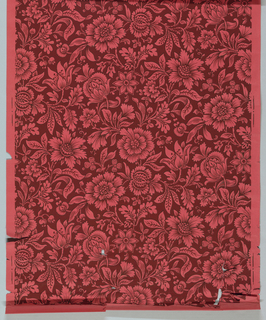 Stylized chintz-type overall floral design. Printed in two colors. The background is printed deep red with the floral motif being the unprinted red ingrain paper. Each motif is outlined with a fine black line.