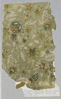Pattern of foliage, clover, vaguely India-chintz derived blossoms on gray ground, outlined in mustard, grayed pink and blue with white highlights. Aesthetic or anglo-Japanesque in style.