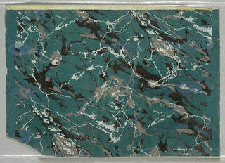 On dark green-blue semi-glossy ground, cut stone imitation - possibly marble - with gray, white, and black veins.
