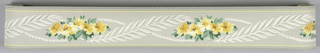 Floral and frond motif in yellow/green/gray/white with gray banding at outer edges on gray ground. Matching ready-pasted border.
