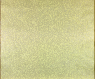 All-over design of irregular yellow-green crackling or heavy creasing on gray ground; effect of extremely worn leather