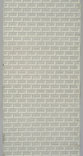Small-scale brick pattern in grisaille with a recessed central panel. Each brick measures 3x6 cm.
