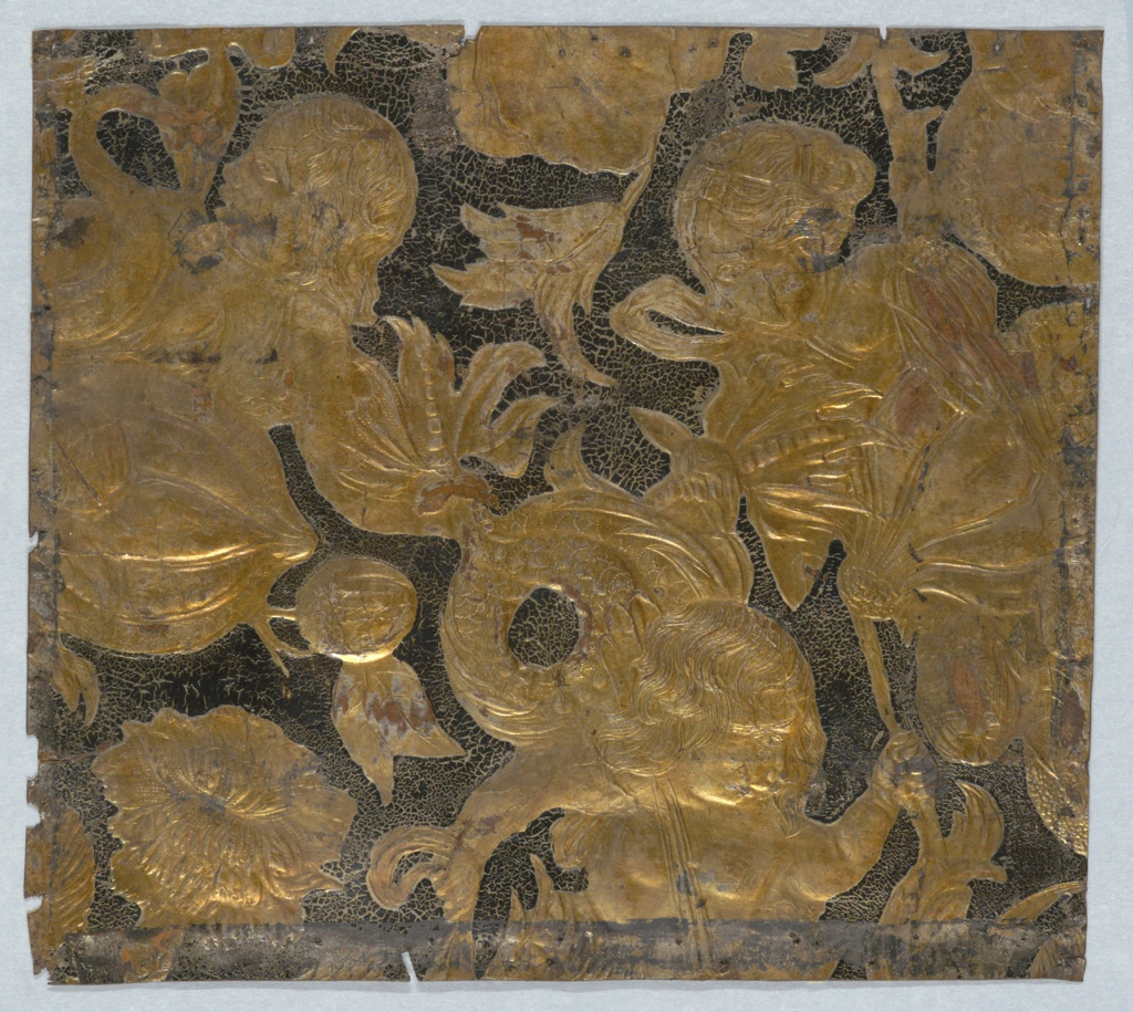 Three mermaid figures, with fruit and foliage. Embossed and gilded.