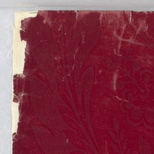 Portion of paper, a complete width giving less than one repeat of an axial design of large-scale foliage with fruit, in the style of Louis XIV. Printed in flock in two tones of dark red.