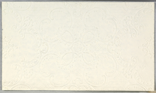 White embossed Anaglypta. Central floral motif, extending out into four scrolling medallions. Trellis pattern between medallions.