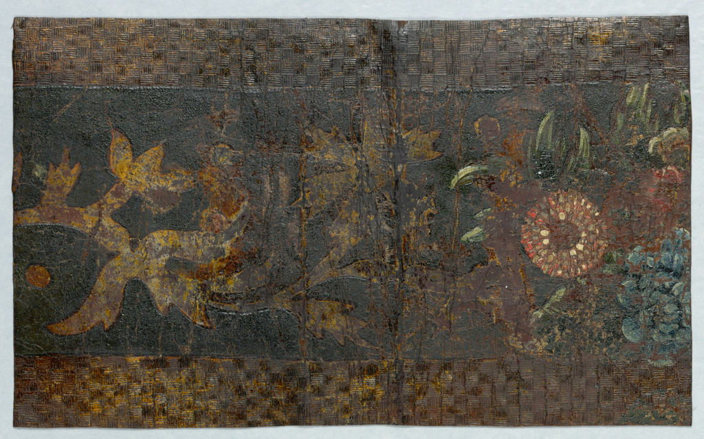 Wide central band of floral and foliate motif. On either side are bands of a checkerboard pattern, embossed and gilded.