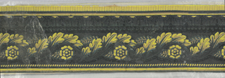 Wide central band of intertwined acanthus leaves, forming a guilloche-like design. Above this is ros of beading and tongue and leaf molding. Row of dentil motif along top edge with narrow band of cable molding or rope twist along lower edge. Printed in shades of yellow, ocher and gray on black ground.