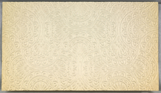 White embossed Anaglypta. Circular arches forming an hour glass shape, interlocked with identical perpendicular shapes.