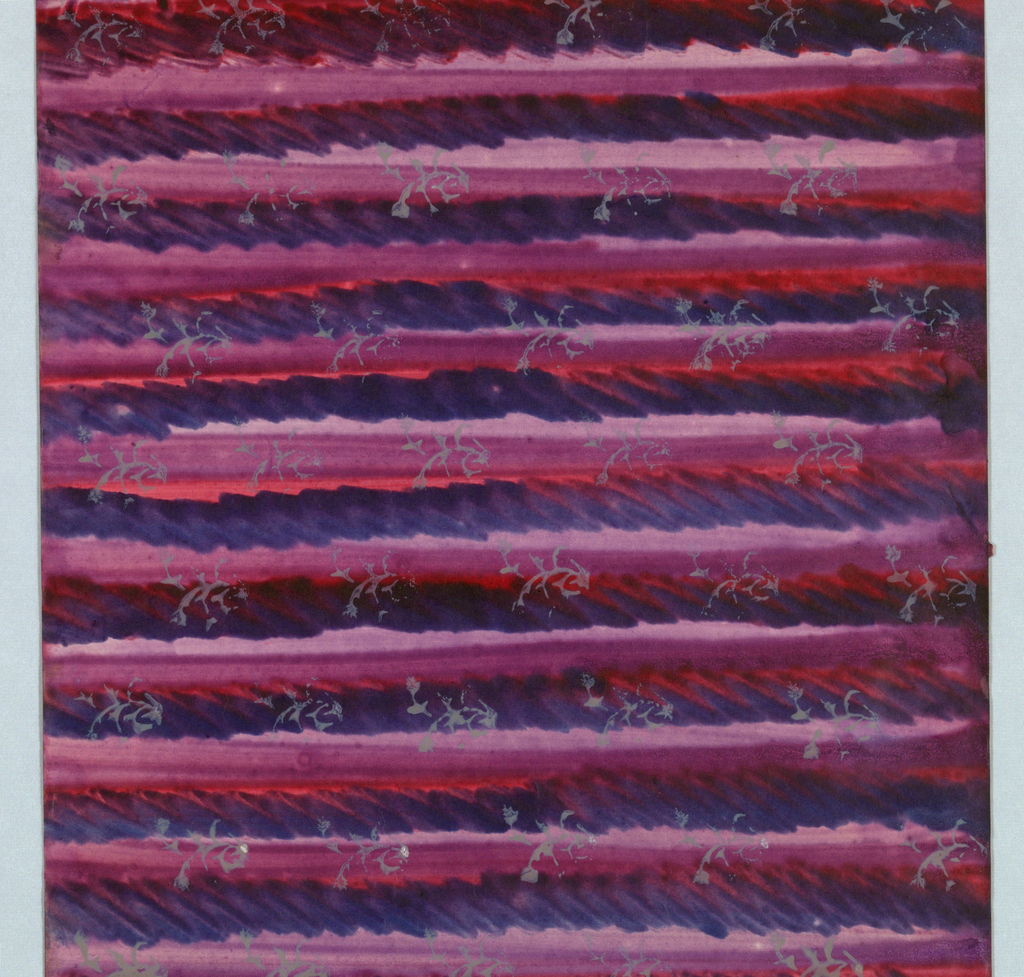 Wiener Werkstätte (Vienna Workshop) design for decorated paper:  hand-painted stripes in black/brown, purple, lavender, and red, overlaid with repeat pattern of small gray sprigs or branches.  The stripes bleed through the thin paper.