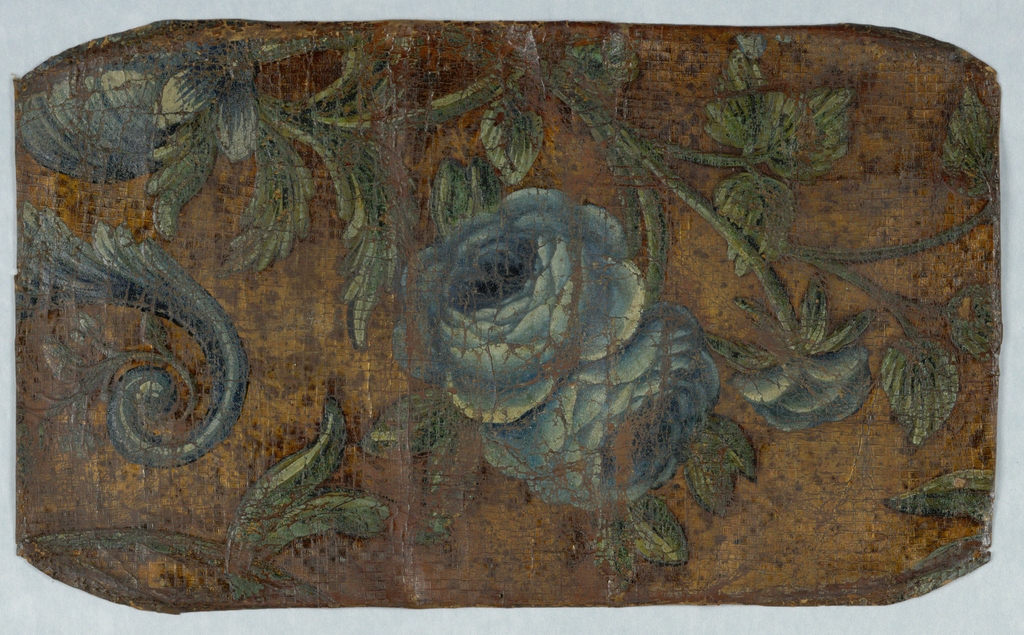 Large blue flowers on vine, with scrolling foliage. Background embossed to simulate weave pattern.