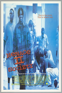 Poster for the Spike Lee film Menace II Society. Two young men walking toward the viewer. The one at front wears a plaid shirt; the other, a cross necklace. In the background a group of youth. The entire scene in shades of blue.