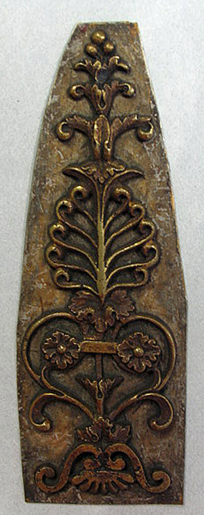 Pierced compound anthemion motif soldered to flat brass plate.