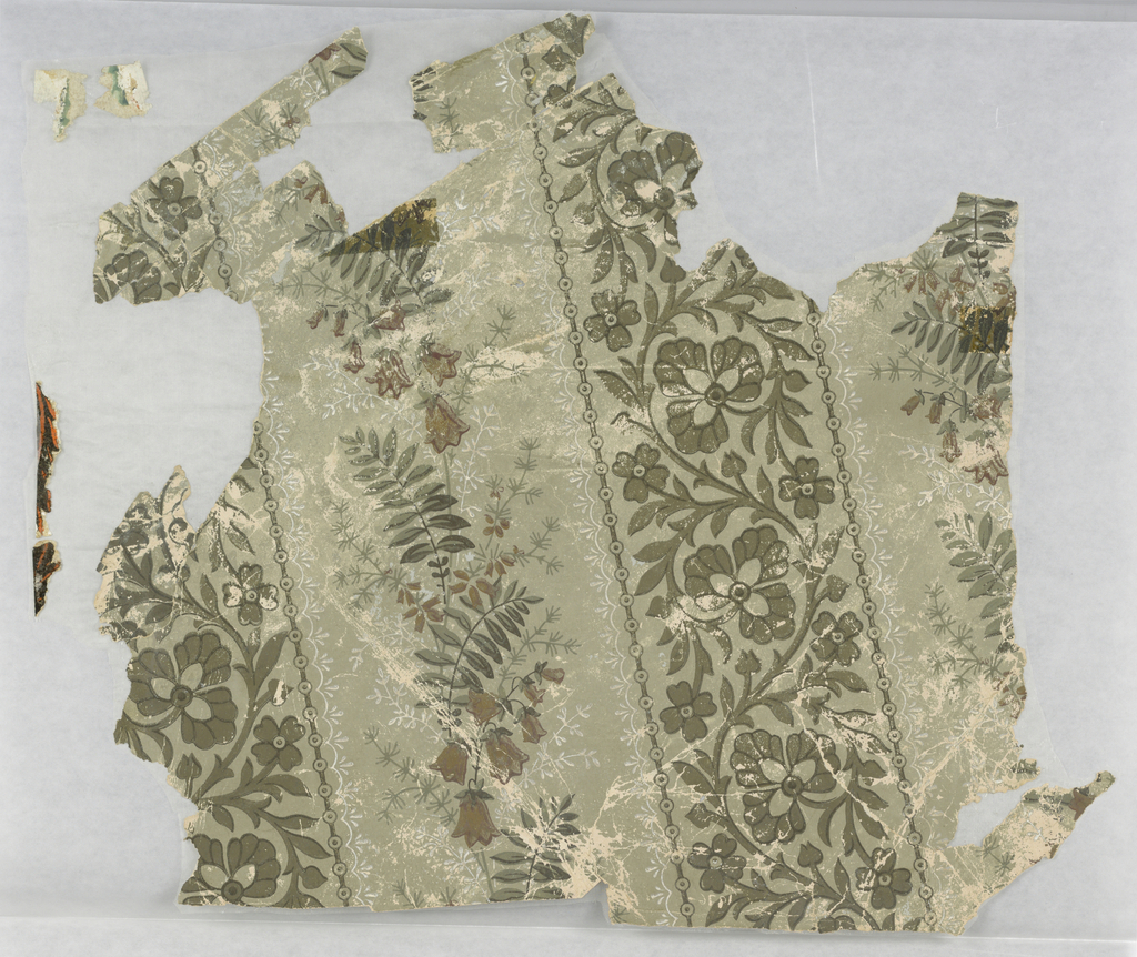 Aesthetic-style, floral stripe design. Wide bands of foliage and bell flowers alternating with narrower bands of foliate rinceau. Printed in green and brown on sage green satin ground.