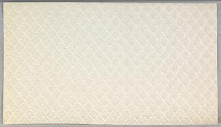 White embossed Anaglypta. Small diamond trellis pattern.