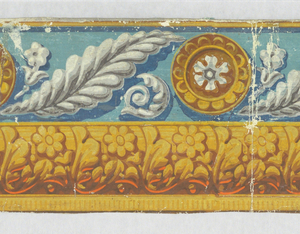 Border is divided into two distinct pattern bands. The upper band consists of a feather-like leaf, flanked by a conventional flower and acanthus curl, alternating with a rosette-centered medallion. The lower band is an architectural row of leaves and flowers edged in dentilling. Printed in four shades of gray, white, turquoise, dark blue, gold, ocher, rosse, brown and orange.  H# 516