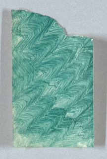Wiener Werkstätte design for decorated paper: green undulating zigzag lines, placed diagonally on sheet, which is a small fragment of larger sheet. Most of the top right corner is torn off, leaving jagged edges.