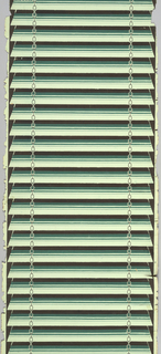 Venetian blinds, printed in shades of green and black. A single chain runs down either side.