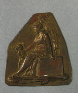 Polygon with straight lower edge. Repoussé figure of seated woman facing left, looking down at a small winged figure.