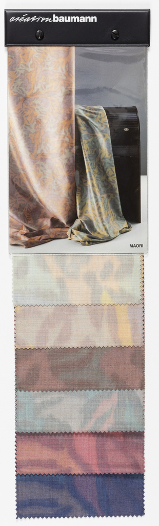 "Sample book with photograph of two lengths of ""Maori"" fabric draped on the cover. The book contains six colorways of the fabric."