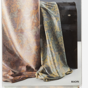 """Sample book with photograph of two lengths of """"Maori"""" fabric draped on the cover. The book contains six colorways of the fabric."""