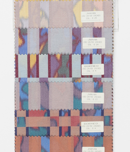 "Sample book with a photograph on the cover showing two lengths of ""Borneo"" draped. The book contains samples of ""Borneo"" and ""Java"", seven colorways of each pattern."