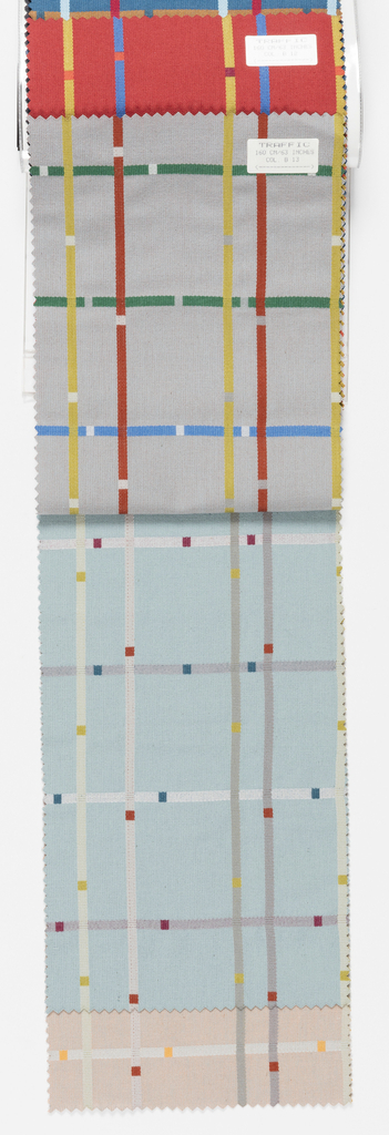 """Sample book with a photograph on the cover of a draped length of """"Traffic"""". Book contains six colorways of """"Traffic""""."""