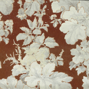 On flocked deep red ground, two identical columns of varying clusters of grisaille leaves and flowers - all finely outlined in light brown - drop repeat. The groupings of flowers form a diaper pattern.
