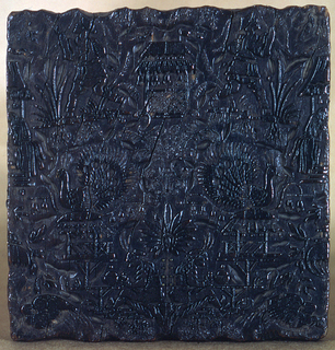 Carved block for printing textiles in a design showing people, peacock, and plant forms in a chinoiserie style. Grooves in the sides for handling.