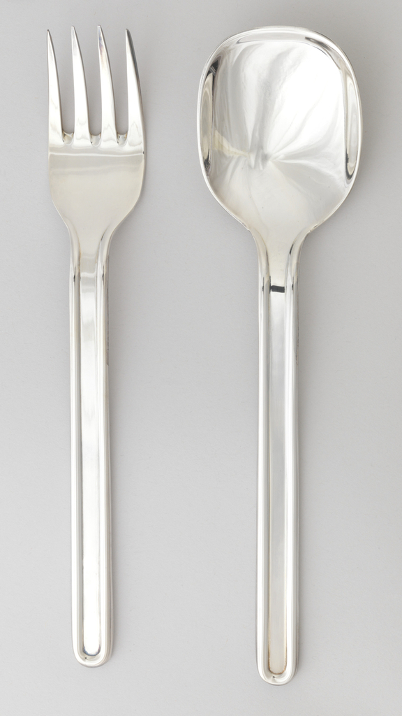 Four-tined with flat, long rounded-rectangular handle with raised-rounded border.