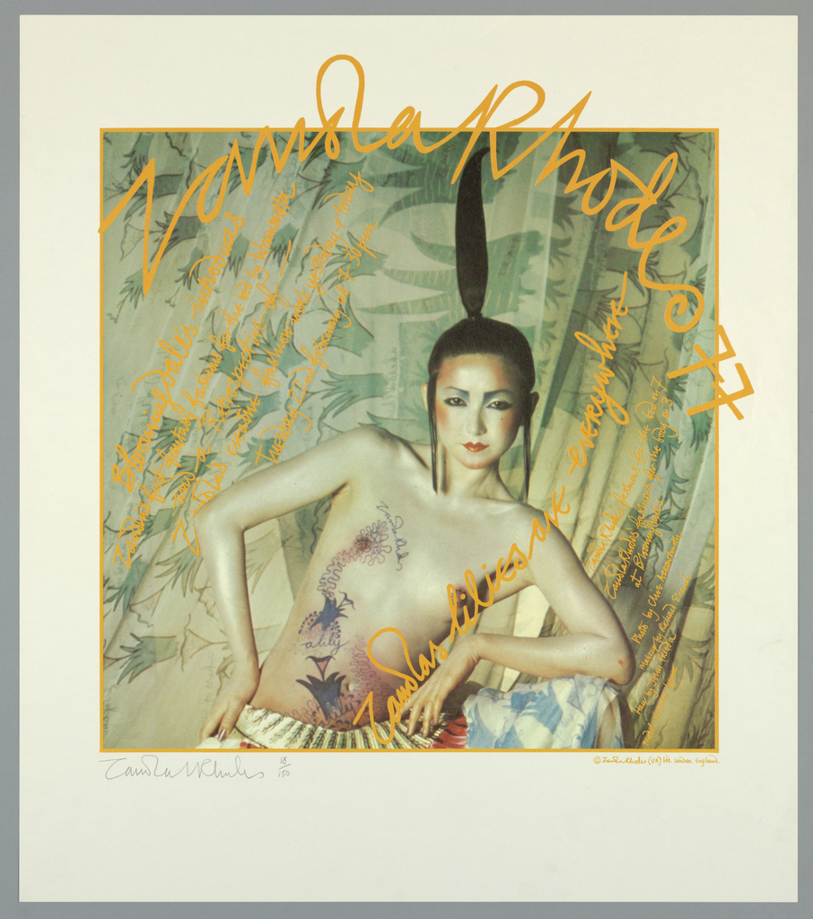 Poster depicts a nude woman with tattooed drawings on her body of … hair is coiffed with ponytail sticking straight up to the sky; she has one elbow resting on a her knee (legs are open, but cropped). She stands against a curtain in light and dark green with leaves. Across poster is script writing in mustard yellow: Zandra Rhodes 77 / Bloomingdales / Zandras lilies are everywhere […].