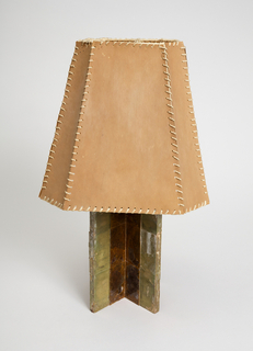 Wooden lamp base covered with sheet mica with paper shade.