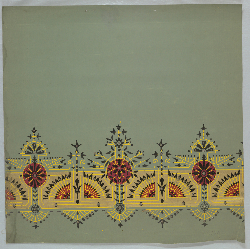 Two stylized plant motifs alternated, each having yellow branches with black leaves, across one end of shade. Each contains a large red circle ornament in the central area.  The plant motifs are printed against a gold background containing fan-like motifs. Printed on a green shade.