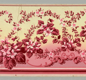 Narrow frieze containing pink and red flowers and leaves, on ground shading from pink at bottom to yellow at top, with sections of irridescent pink.